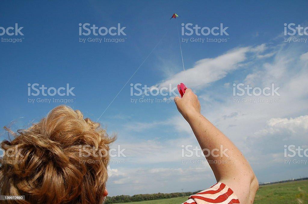 Mom Riding the Kite royalty-free stock photo