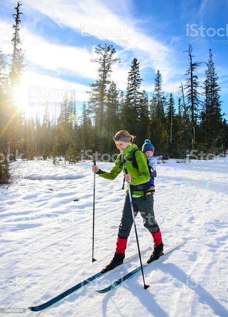 Mom skiing with toddler stock photo