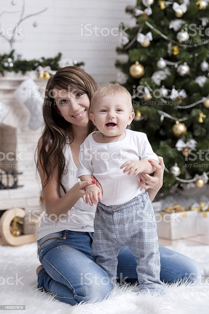 Mom with a child under the Christmas tree royalty-free stock photo