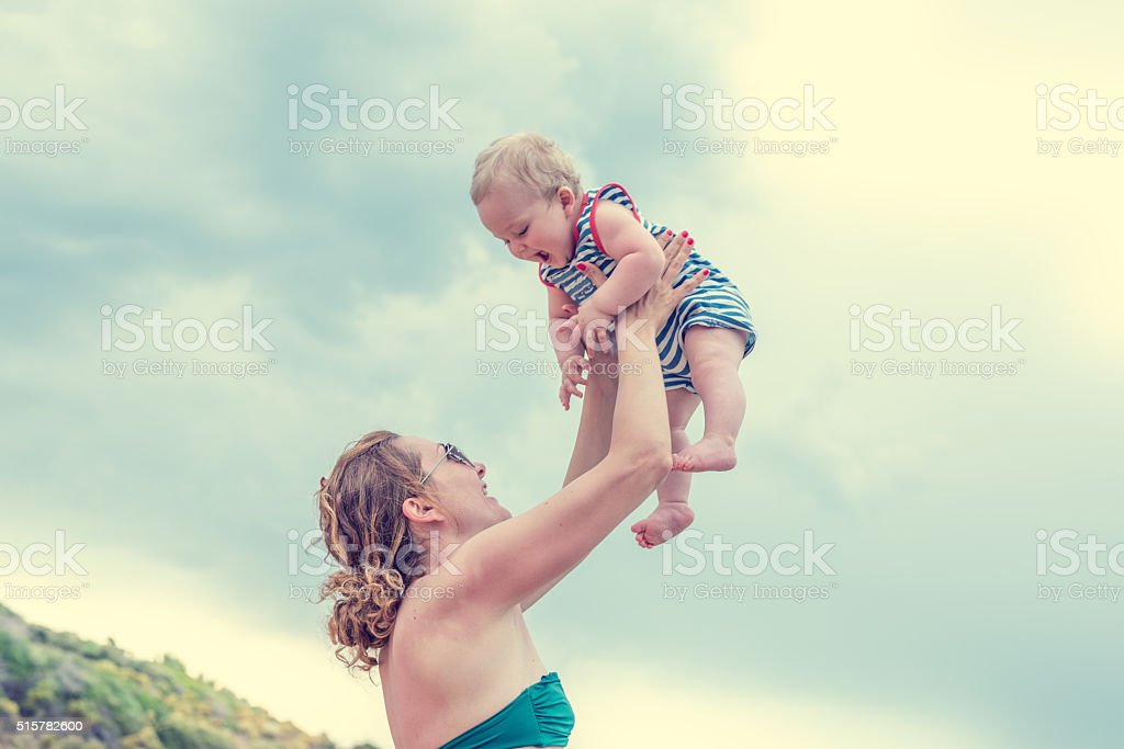 Mom with baby on the beach stock photo