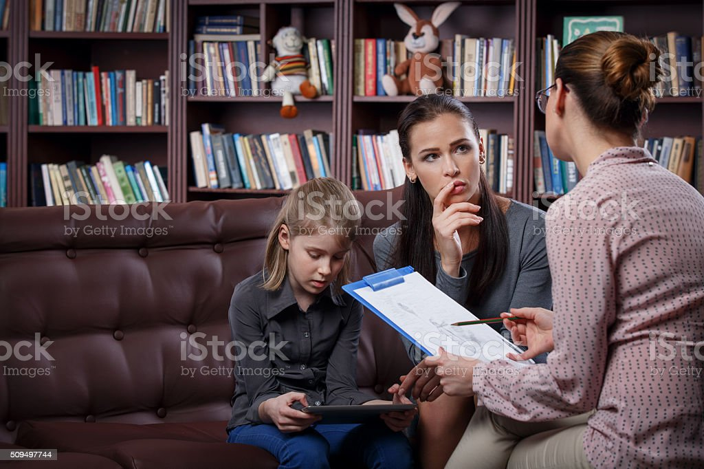 Mom with daugher on consultation stock photo