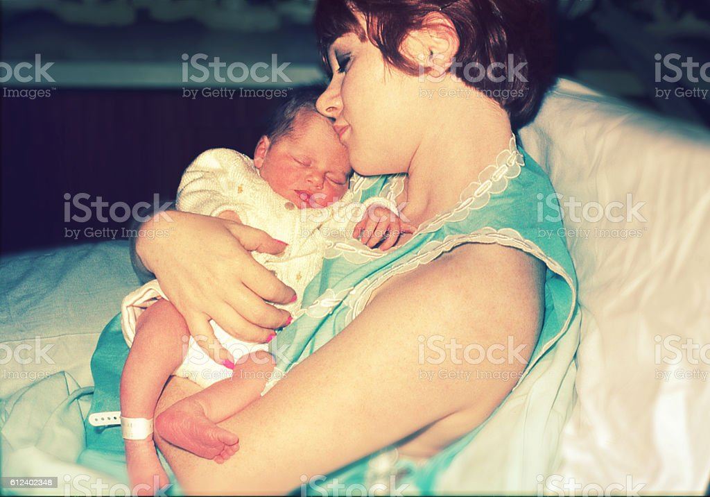 Mom with her just born little baby royalty-free stock photo