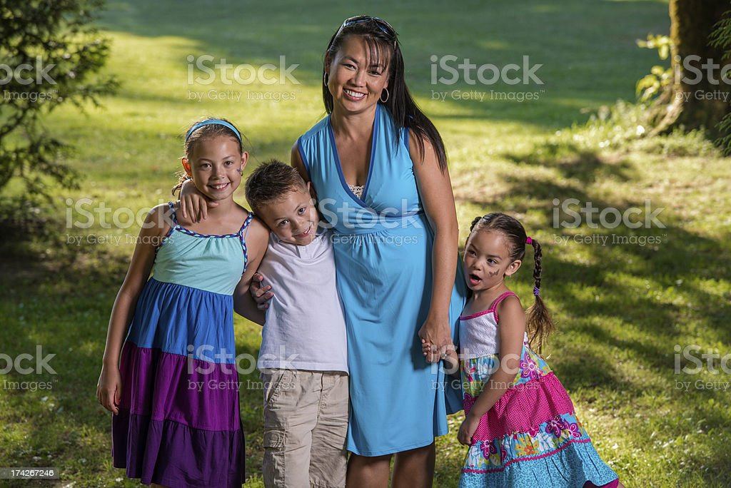 Mom With Three Munchkins royalty-free stock photo