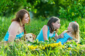 mom with two daughters and dog