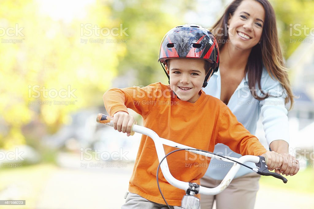Mom won't let him fall stock photo