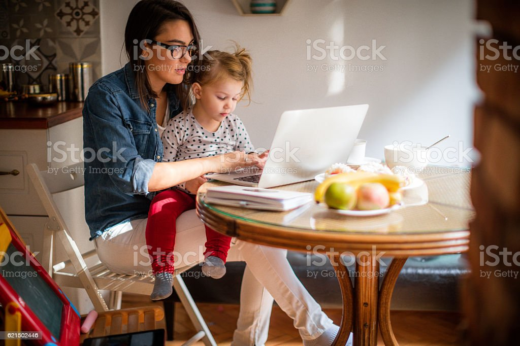 Mom working from home stock photo