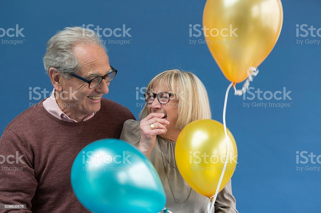 Moment of complicity and joy of a couple of senior stock photo