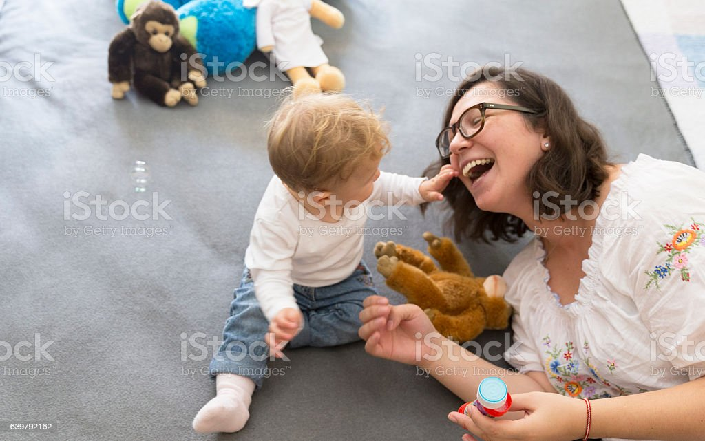 Momma, make bubbles again and again! stock photo