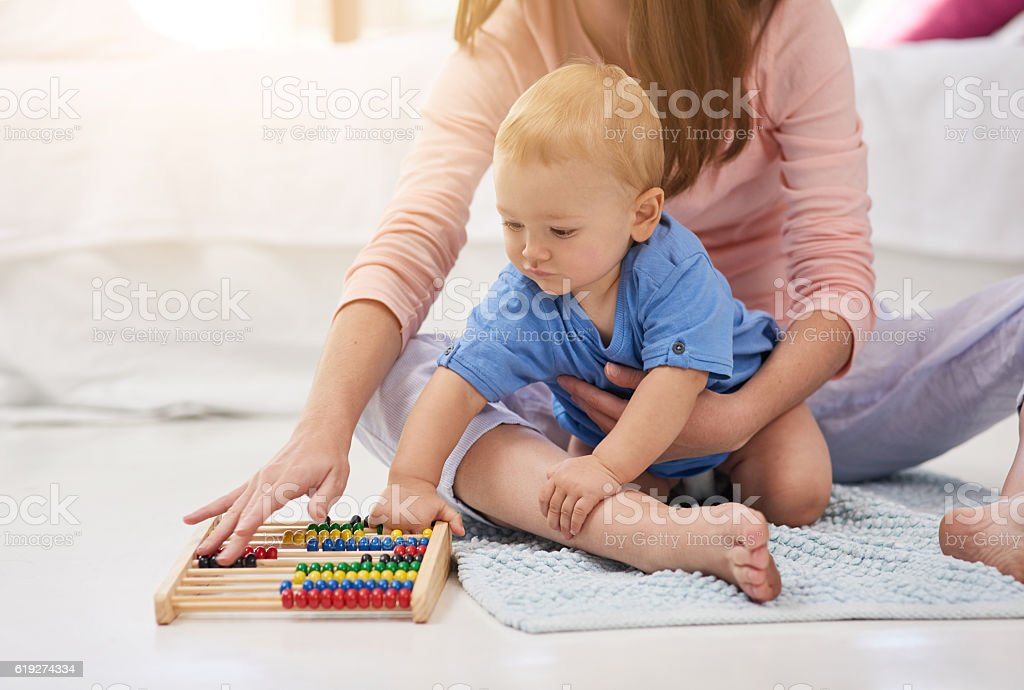 Mommy and her mini mathematician stock photo