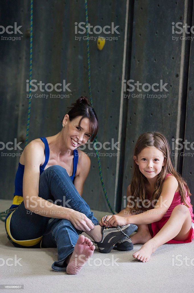 Mommy Daughter Time at the Rock Climbing Gym stock photo