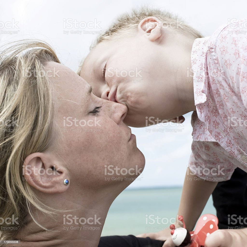 Mommy gets a Kiss royalty-free stock photo