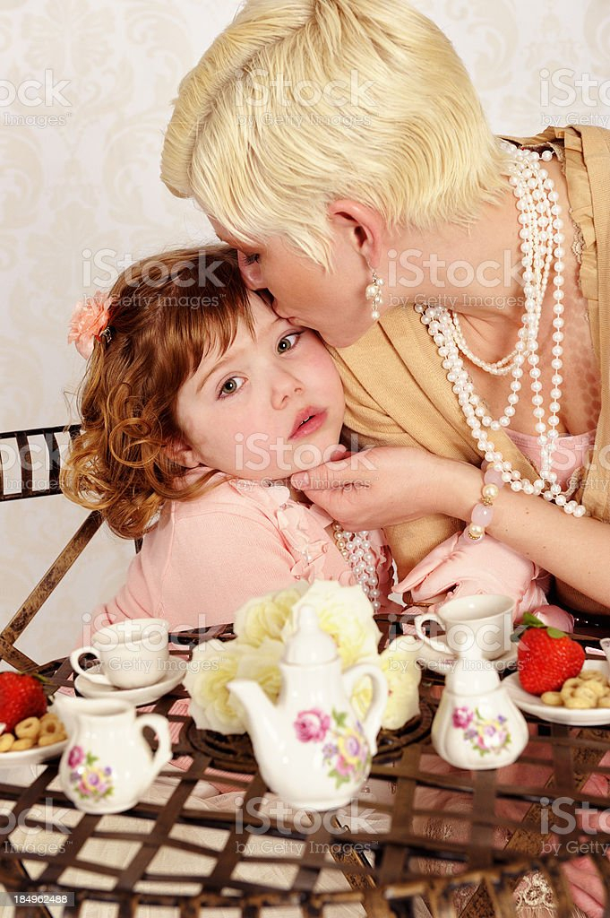 Mommy Makes It All Better With A Kiss royalty-free stock photo