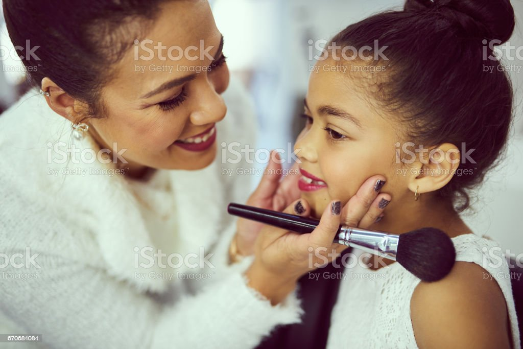 Mommy's little pageant star stock photo