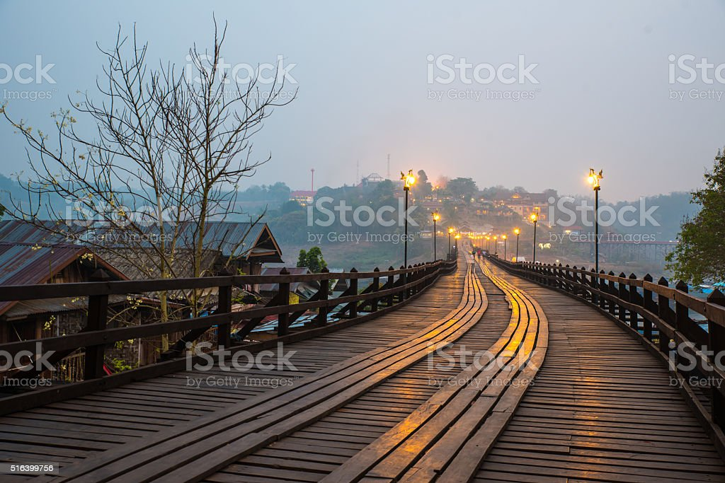 Mon bridge in Thailand under dawn. stock photo
