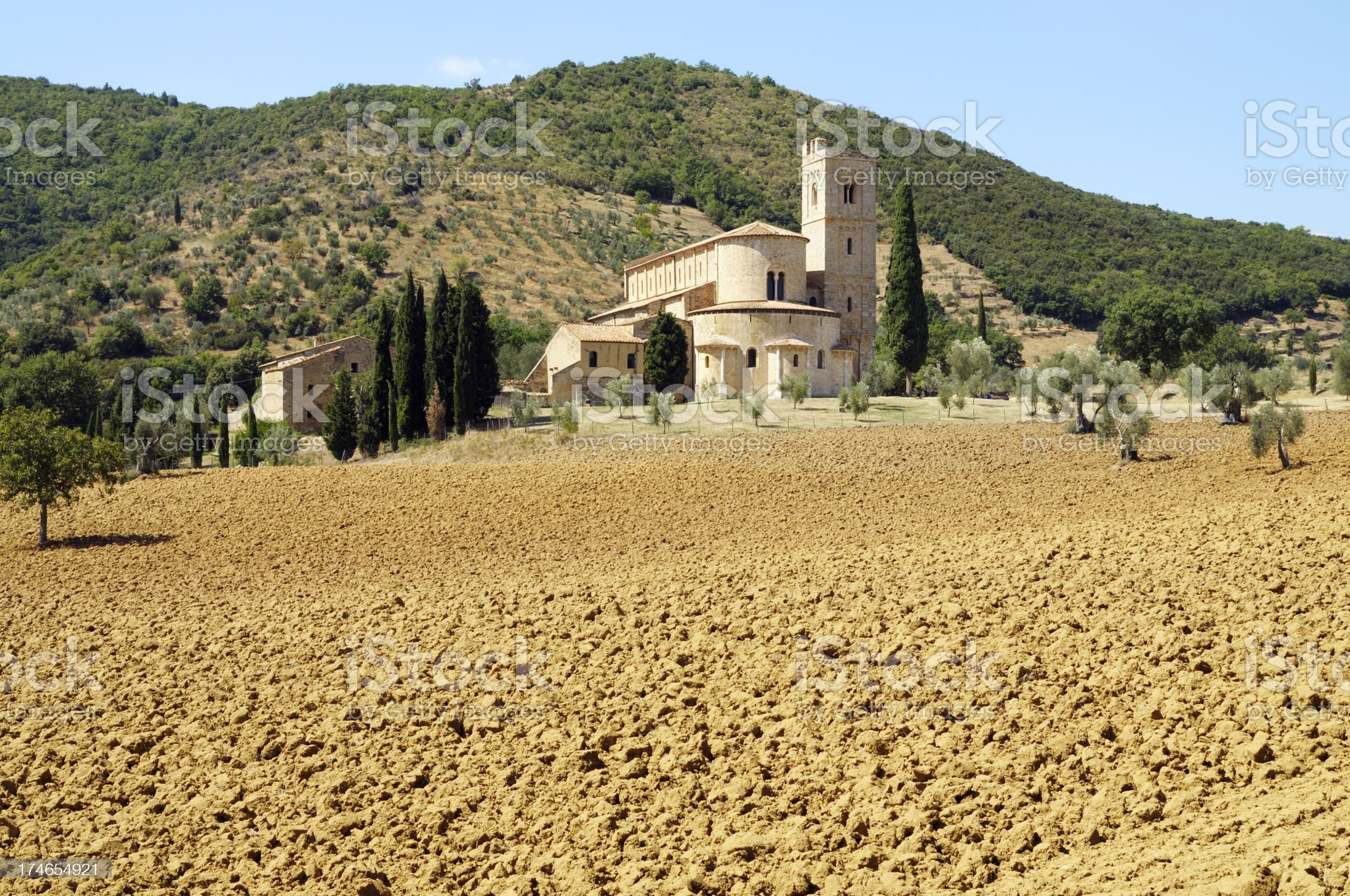 Monastery and plowed field royalty-free stock photo