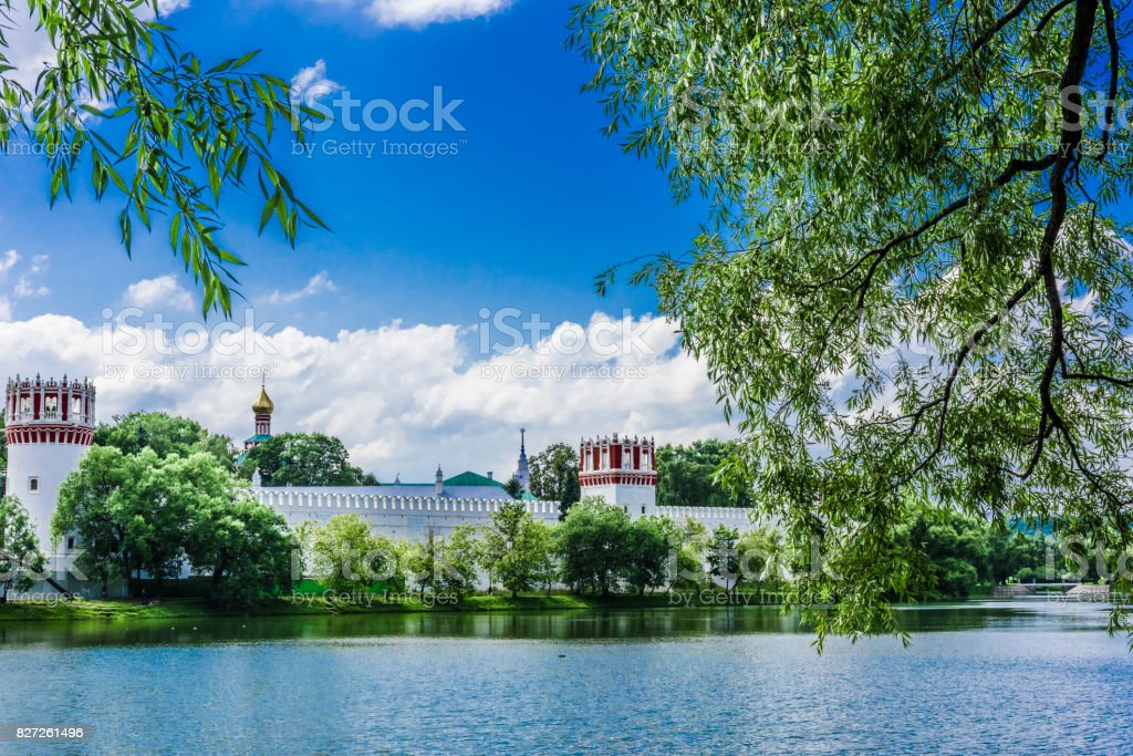 Monastery on the shore of the pond stock photo