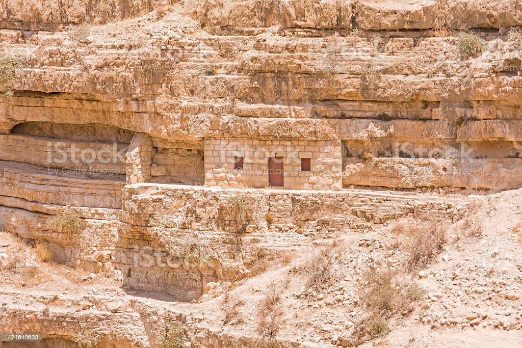 Monastic cave-cell in the mountain wall of Kidron river canyon royalty-free stock photo