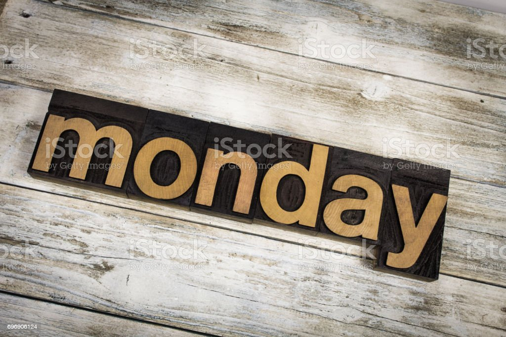 Monday Letterpress Word on Wooden Background stock photo