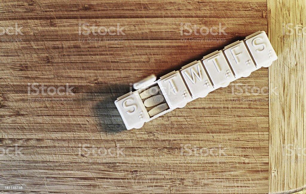 Monday Medicine Grungy Plastic Pill Box stock photo