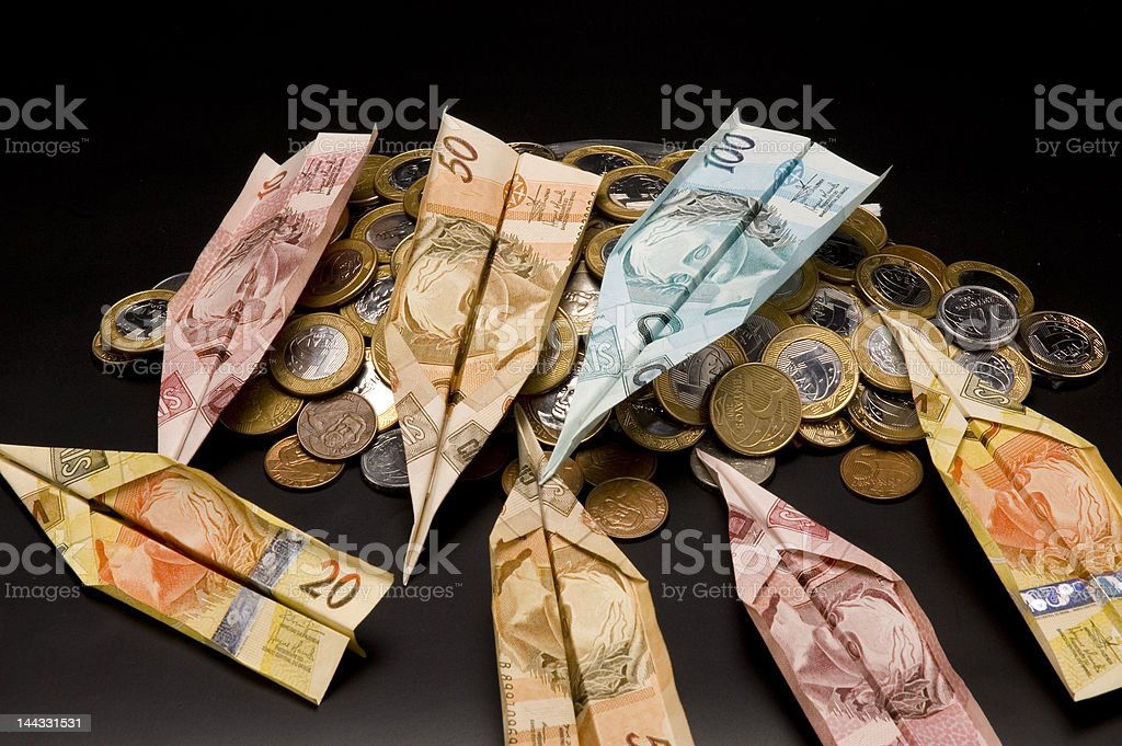 money airplane and coins royalty-free stock photo