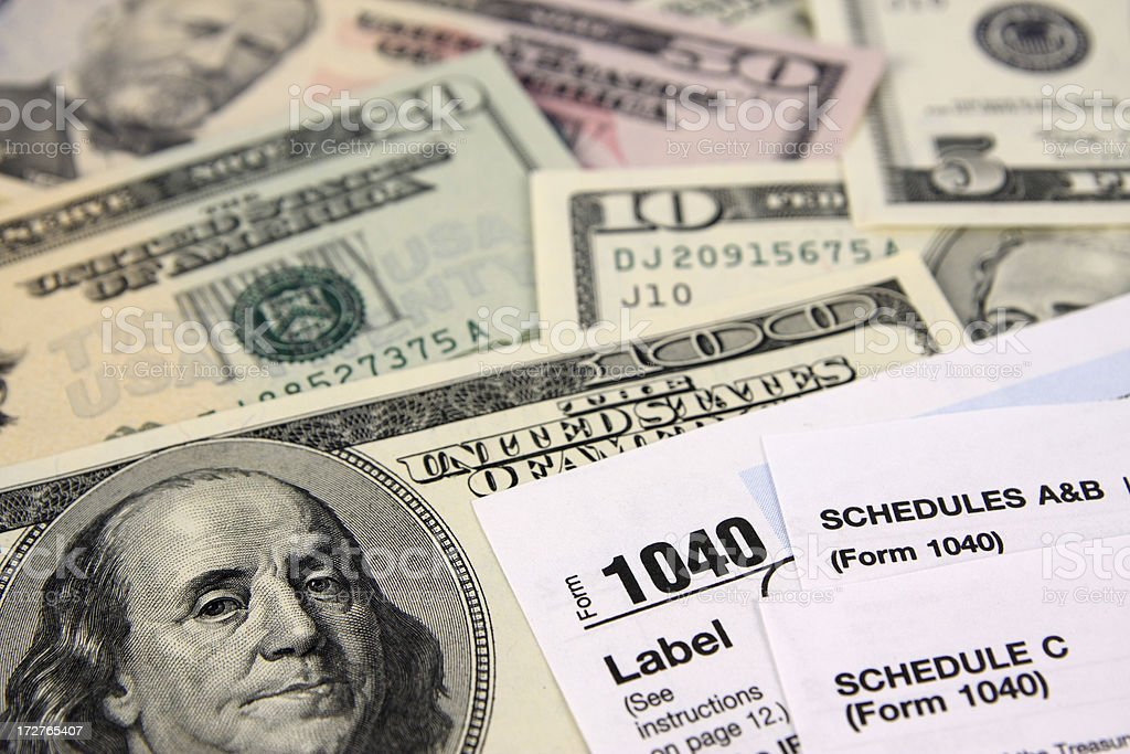 Money and 1040 Tax Forms stock photo