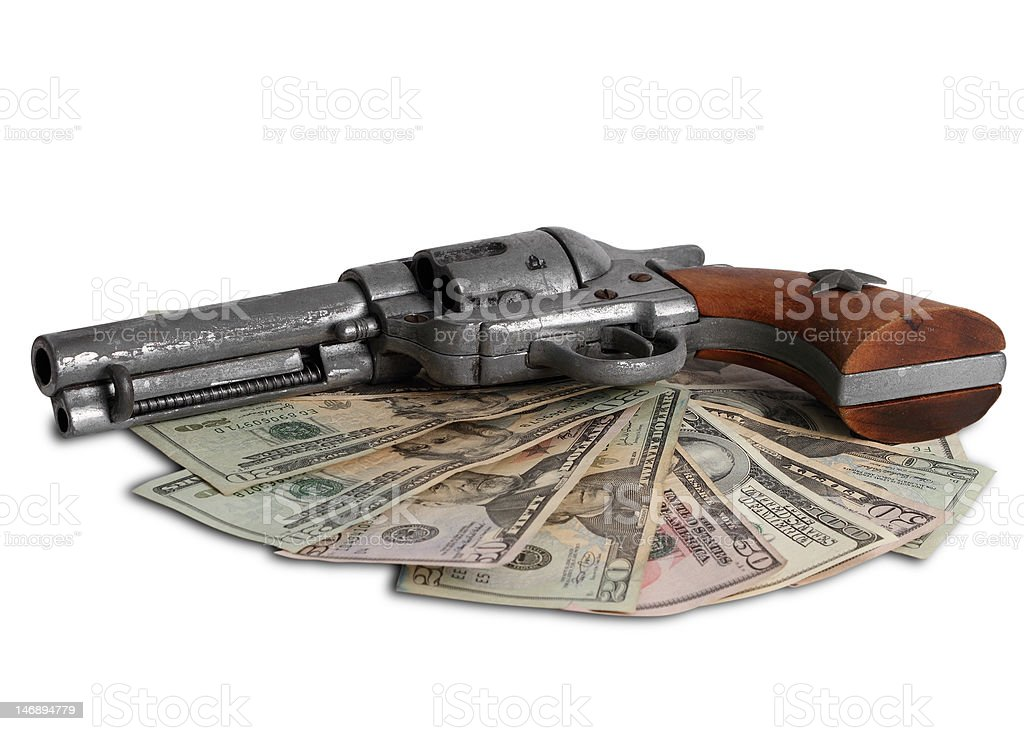 Money and a gun on  Wild West royalty-free stock photo
