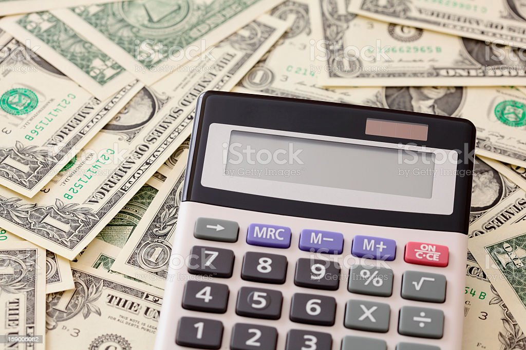 money and calculator with empty screen copy space royalty-free stock photo