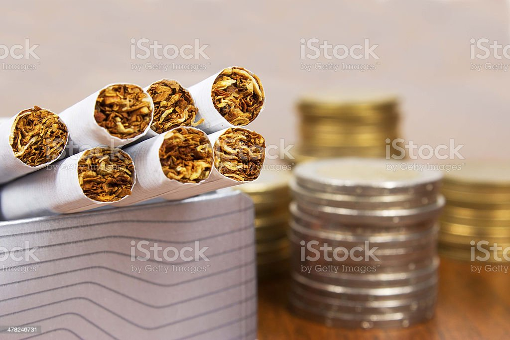 Money and cigarettes royalty-free stock photo