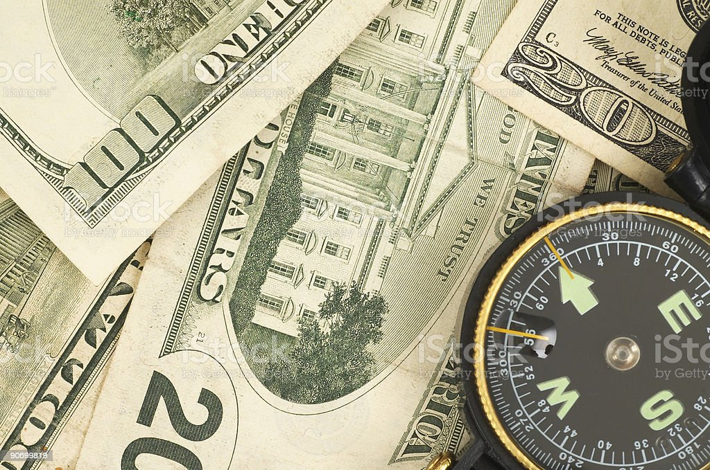 money and compass stock photo