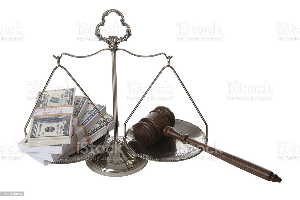 Money and gavel on scale of justice royalty-free stock photo