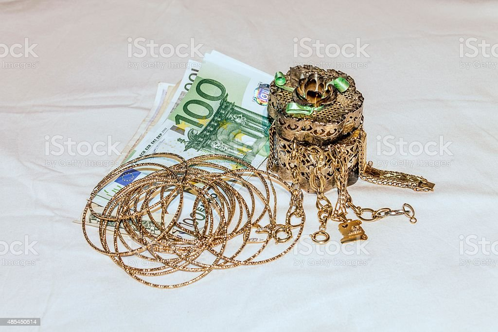 money and gold jewelry stock photo