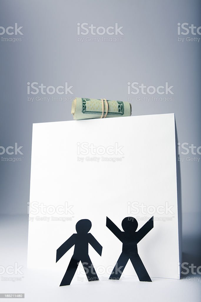 Money and greed - paper person concept stock photo