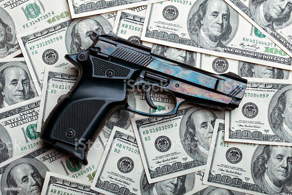 money and gun.dollars stock photo