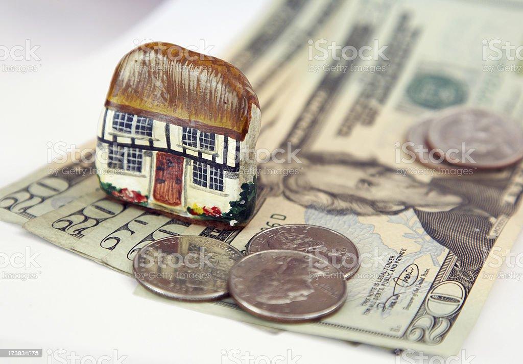 Money and house model stock photo