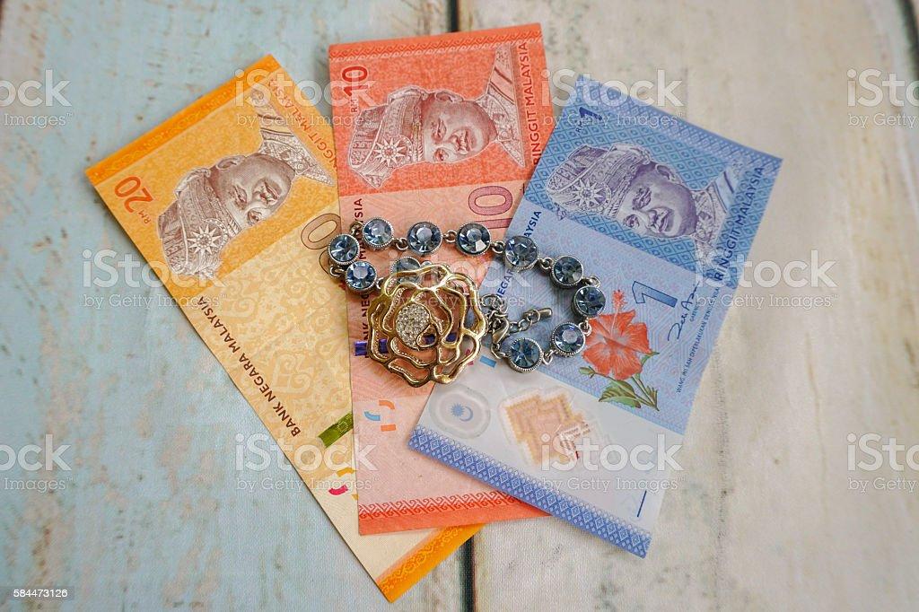 Money and jewellery stock photo