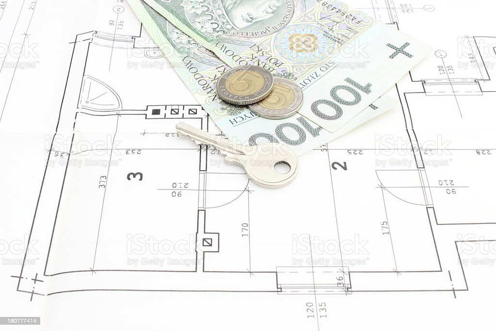 Money and key lying on the housing plan royalty-free stock photo