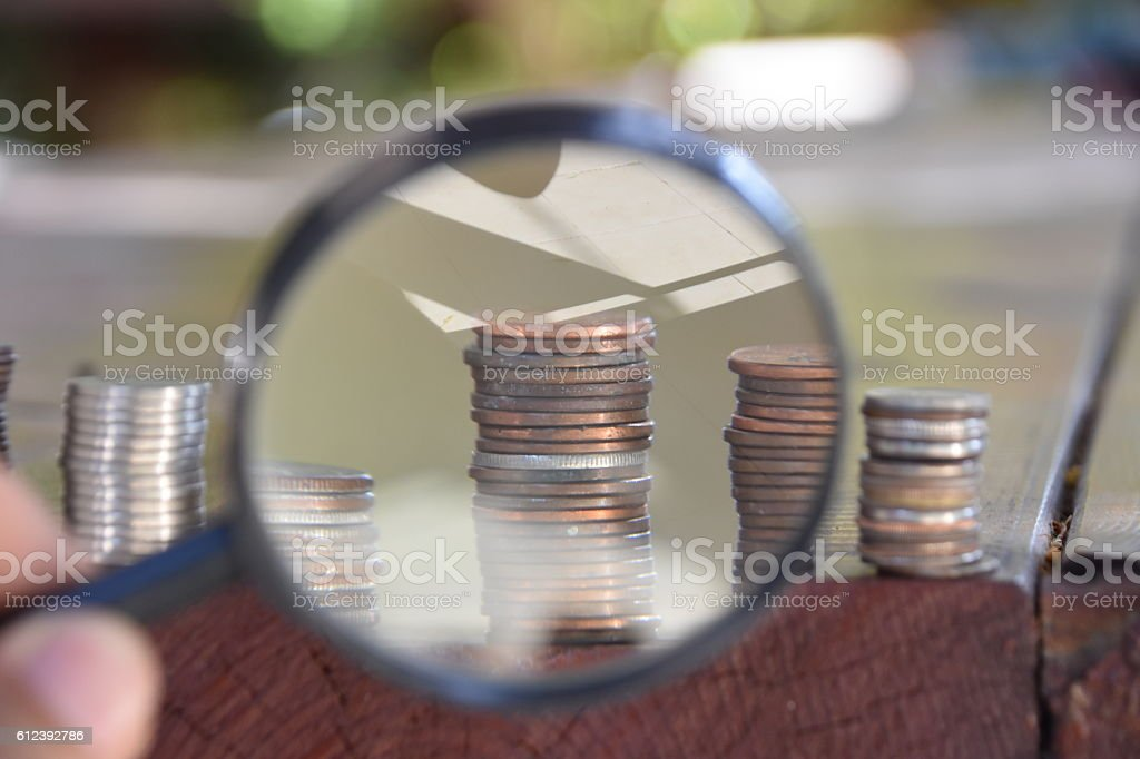 Money and magnifying glass stock photo