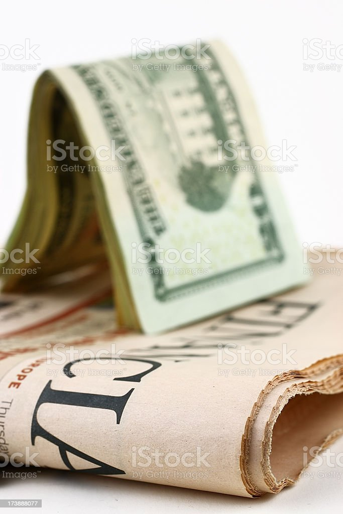 Money and newspaper royalty-free stock photo