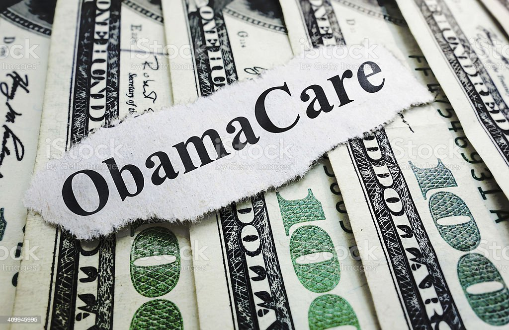 Money and Obama Care stock photo