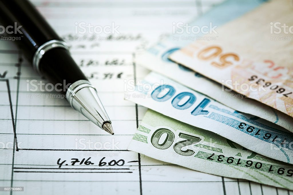 Money and pen on document stock photo