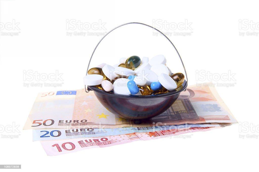 money and pills stock photo