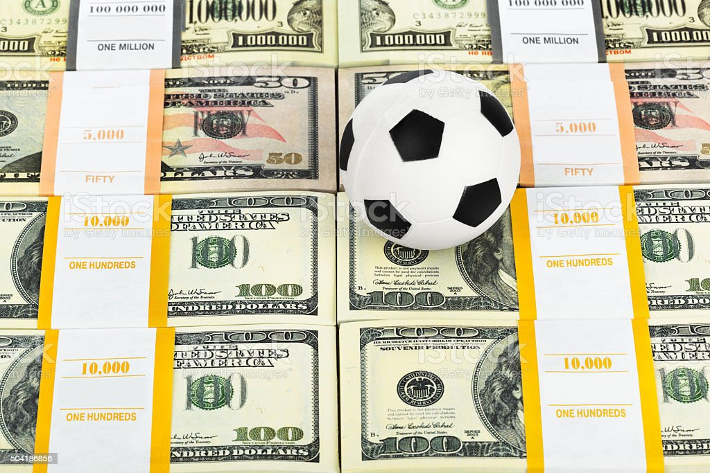 Money and soccer ball stock photo