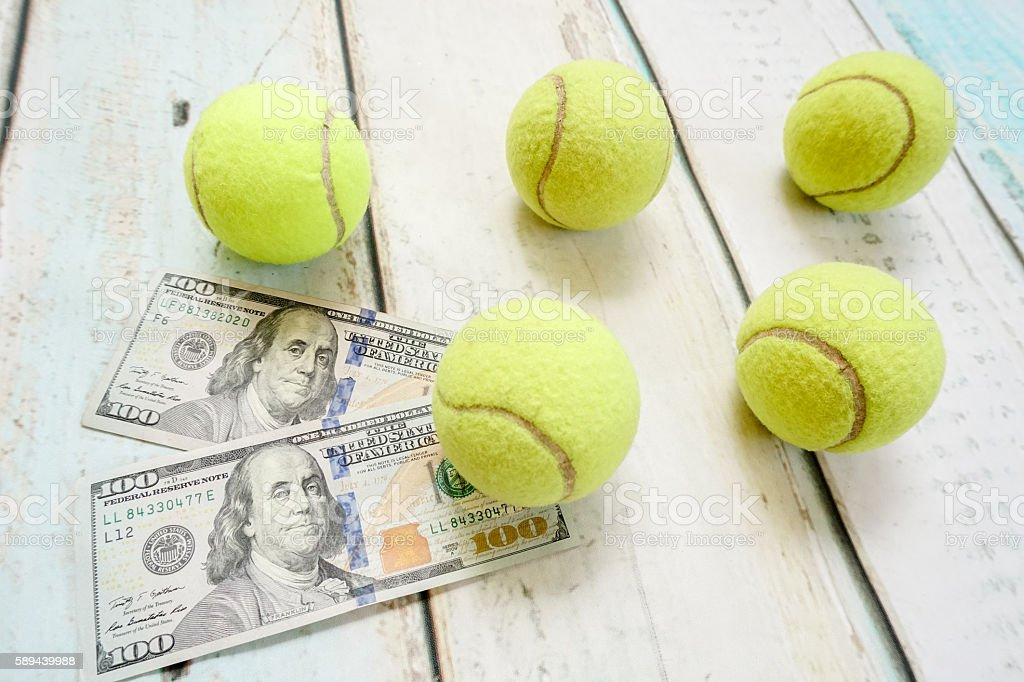 Money and tennis balls stock photo