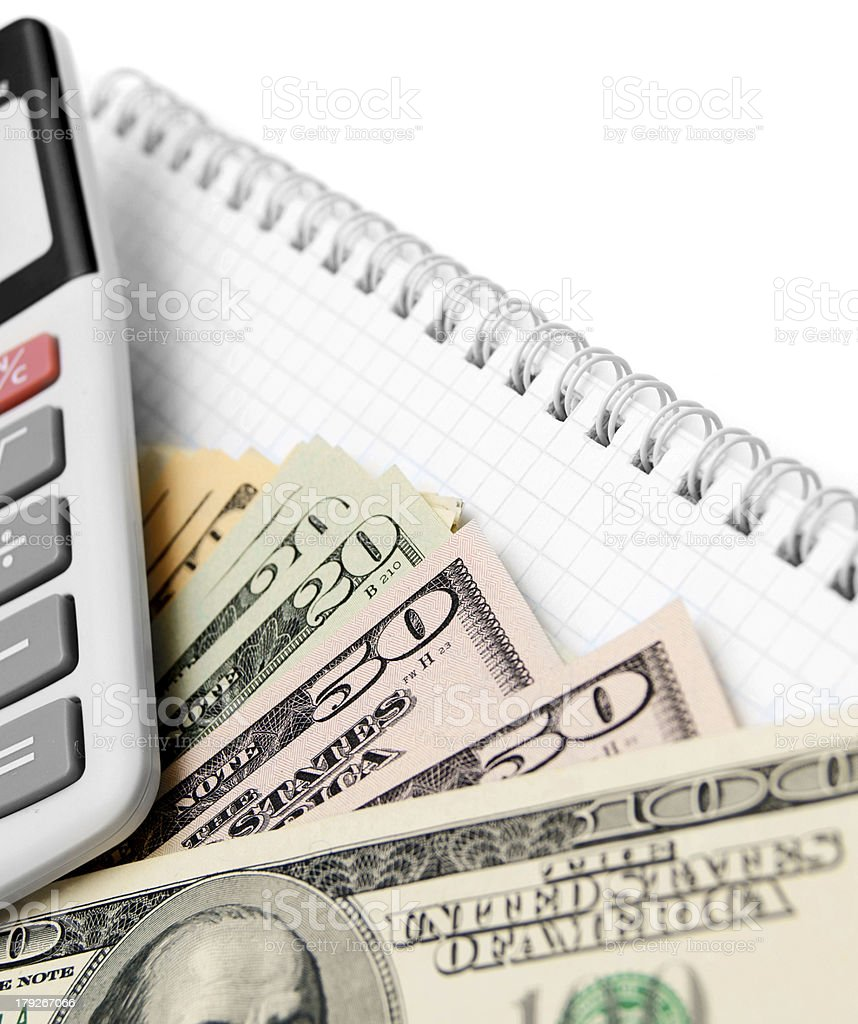 Money and the calculator for a notebook. royalty-free stock photo