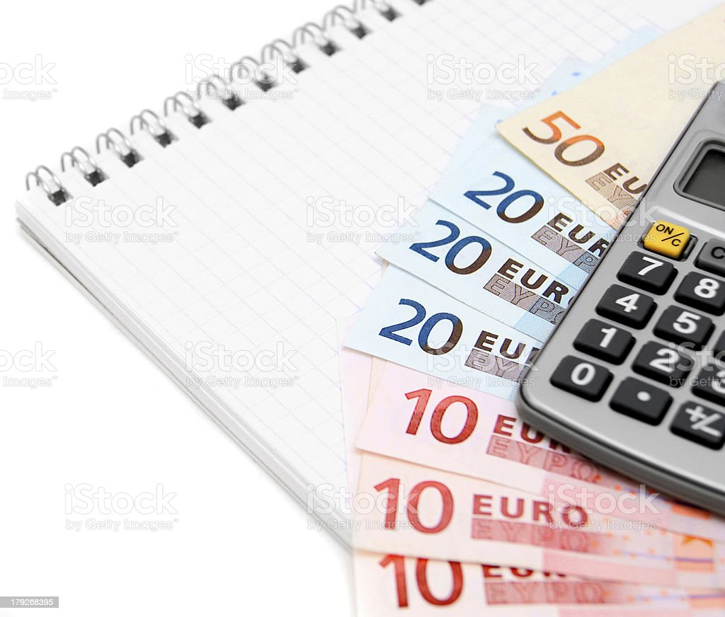 Money (euro) and the calculator for a notebook. royalty-free stock photo