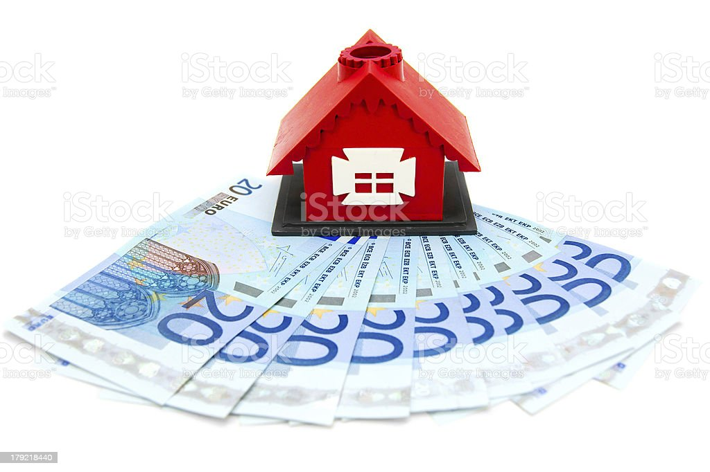 Money and the toy house. royalty-free stock photo