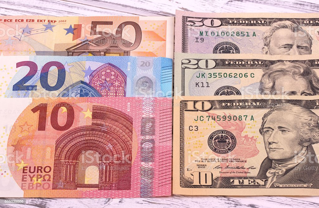 Money background american dollars and euro different denominationson old white wooden plank. stock photo