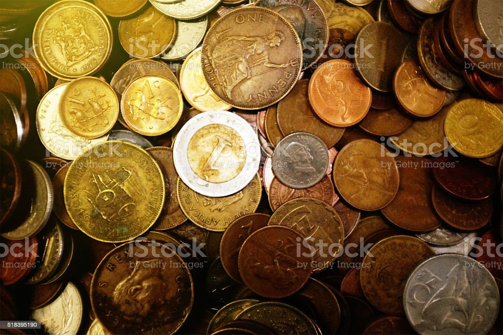 Money background: multiple multi-national coins stock photo