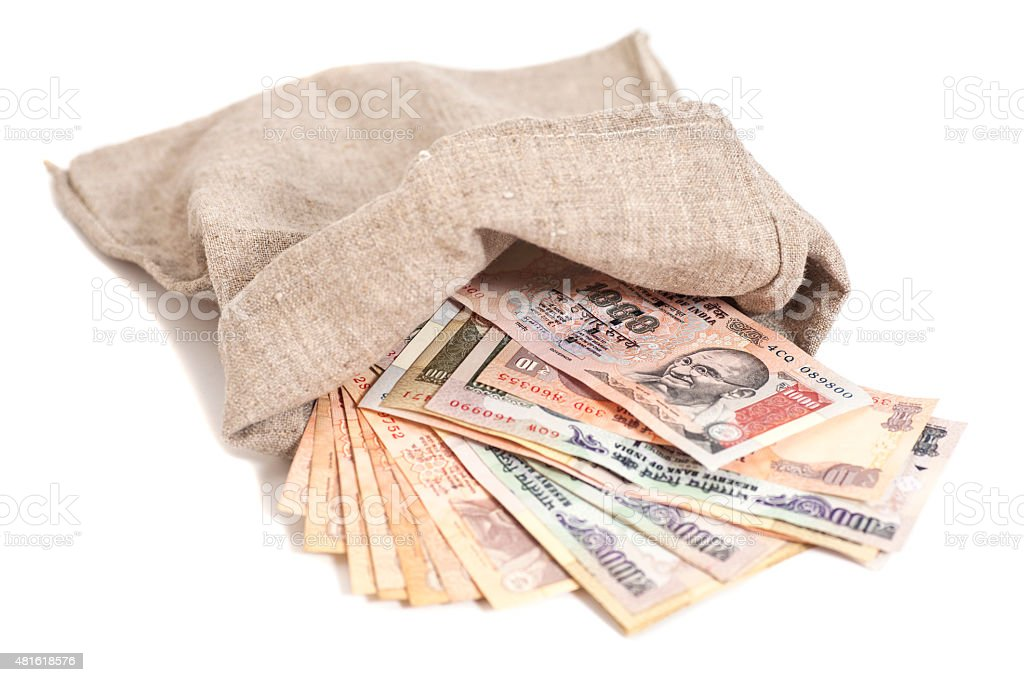 Money bag with Indian Currency Rupee bank notes stock photo