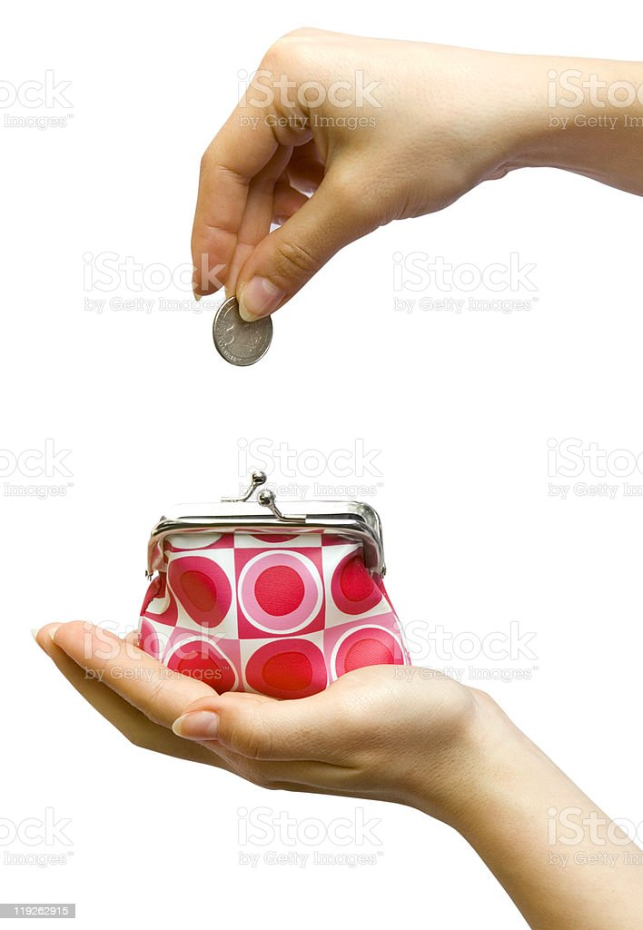 Money being dropped into a colorful purse royalty-free stock photo